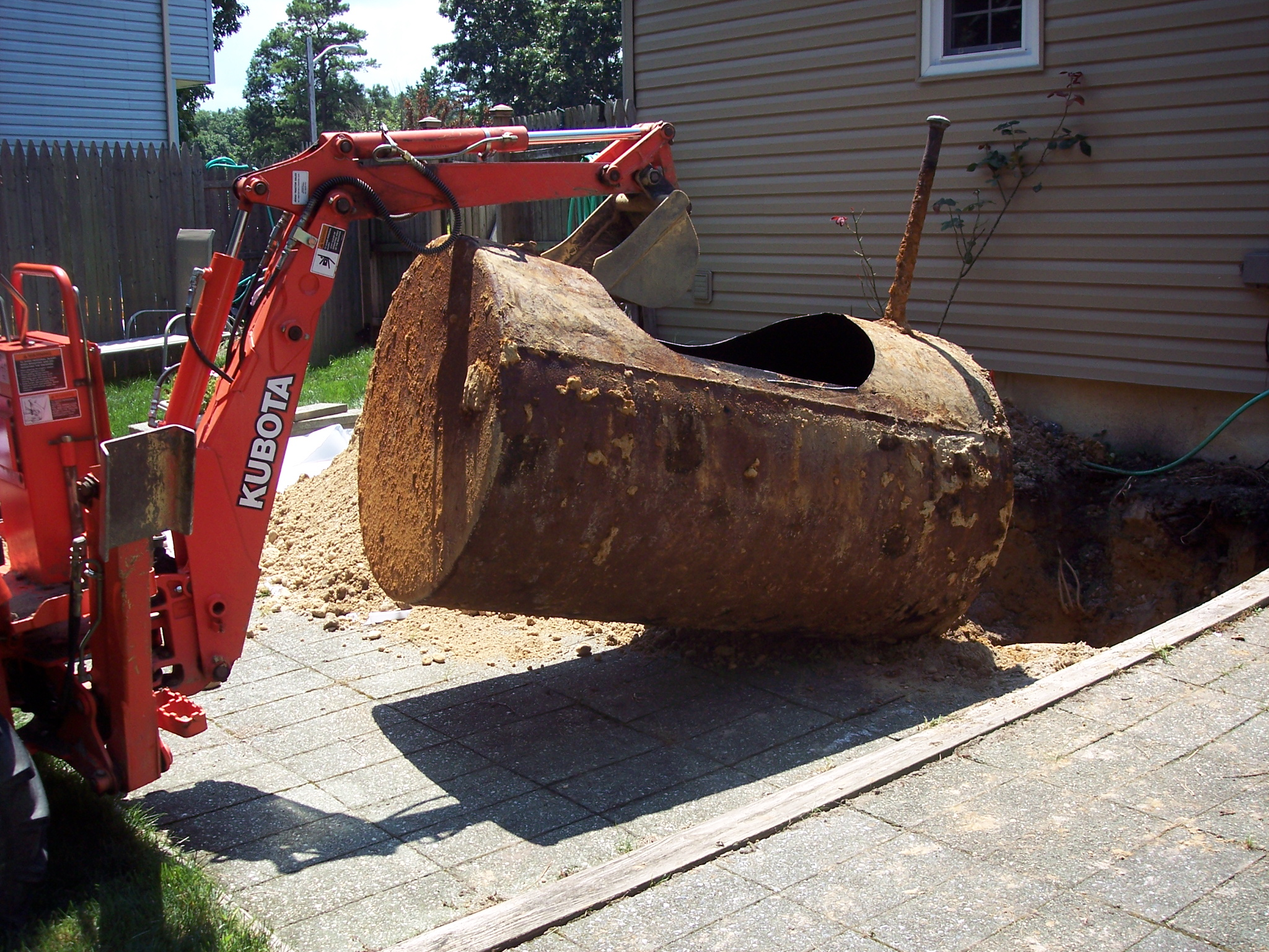 oil tank removal under patio