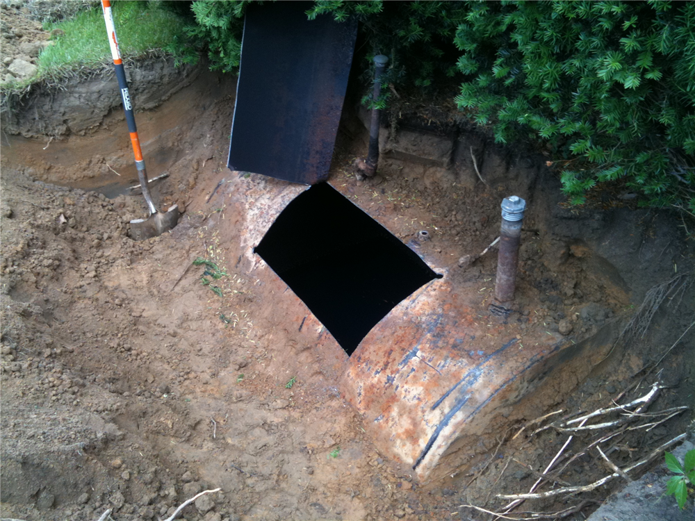 Oil tank cut open prior to entering and cleaning the tank