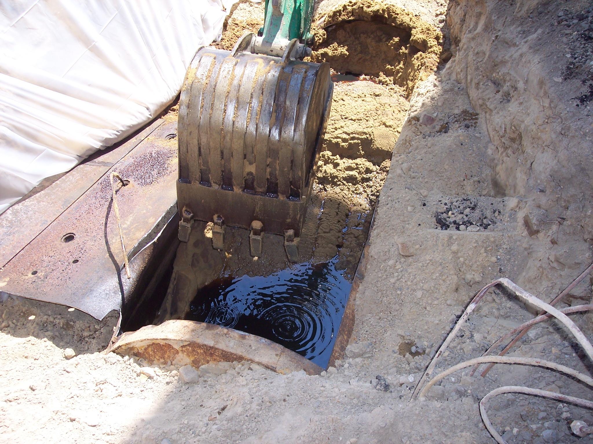 oil found in sand filled tank.jpg